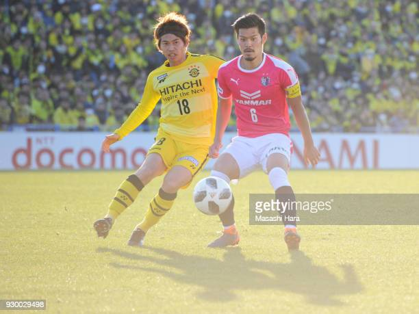 Hotaru Yamaguchi of Cerezo Osaka and Yusuke Segawa of Kashiwa Reysol compete for the ball and their shadows during the JLeague J1 match between...