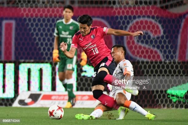 Hotaru Yamaguchi of Cerezo Osaka is tackled by Chong Tese of Shimizu SPulse during the JLeague J1 match between Cerezo Osaka and Shimizu SPulse at...