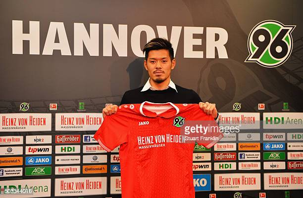 Hotaru Yamaguchi of Hannover holds his new team shirt during a press conference to announce his joining of Hannover 96 on January 4, 2016 in Hanover,...