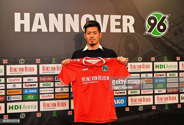 Hotaru Yamaguchi of Hannover holds his new team shirt during a press conference to announce his joining of Hannover 96 on January 4 2016 in Hanover...