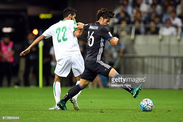 Hotaru Yamaguchi of Japan and Bashar Resan Bonyan of Iraq compete for the ball during the 2018 FIFA World Cup Qualifiers match between Japan and Iraq...