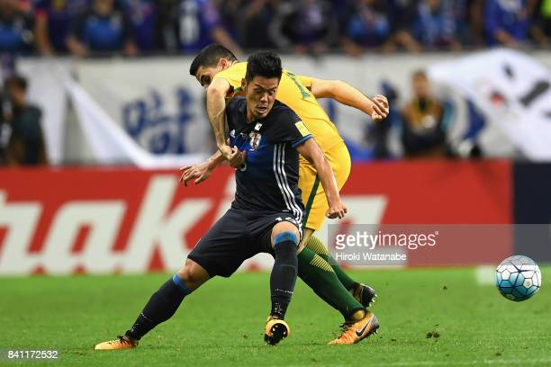 Hotaru Yamaguchi of Japan and Tomas Rogic of Australia compete for the ball during the FIFA World Cup Qualifier match between Japan and Australia at...