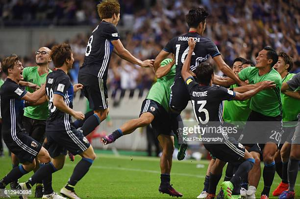 Hotaru Yamaguchi of Japan celebrates his winner with his team mates during the 2018 FIFA World Cup Qualifiers match between Japan and Iraq at Saitama...