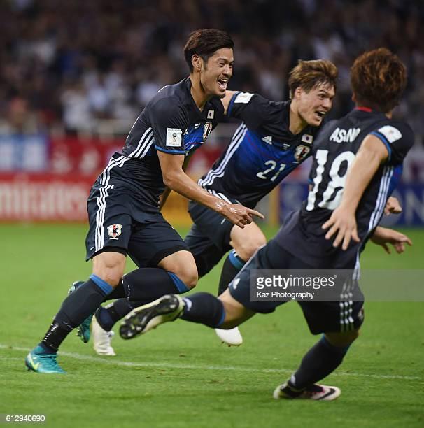 Hotaru Yamaguchi of Japan celebrates the winner with his team mates Gotoku Sakai and Takuma Asano of Japan during the 2018 FIFA World Cup Qualifiers...