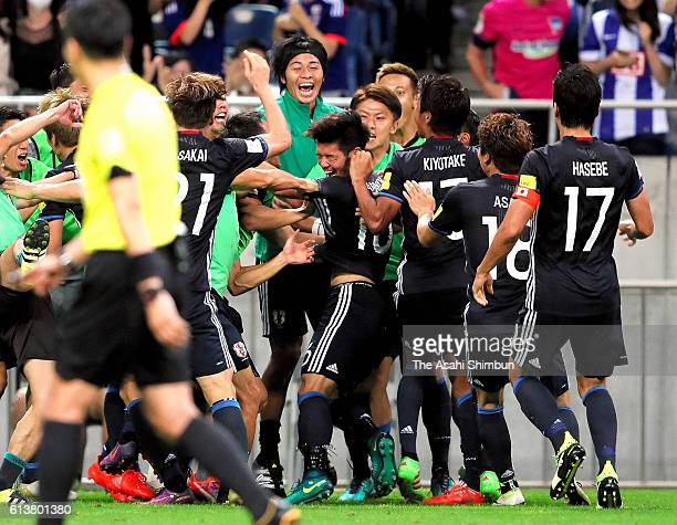 Hotaru Yamaguchi of Japan celebrates with his team after scoring a goal right before the end of the 2018 FIFA World Cup Qualifiers match between...