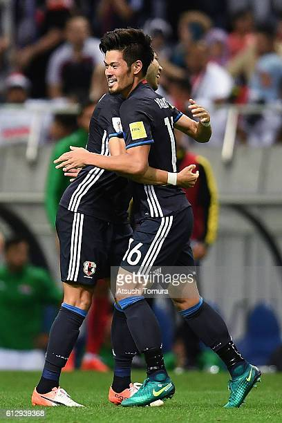 Hotaru Yamaguchi of Japan celebrates with his team after scoring their second goal to win the 2018 FIFA World Cup Qualifiers match between Japan and...