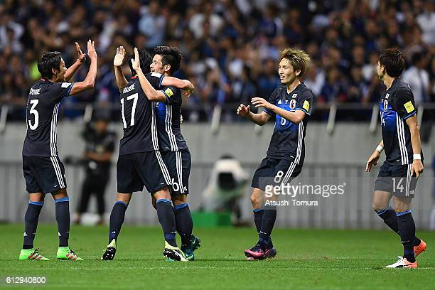 Hotaru Yamaguchi of Japan celebrates with his team mates after scoring their second goal during the 2018 FIFA World Cup Qualifiers match between...