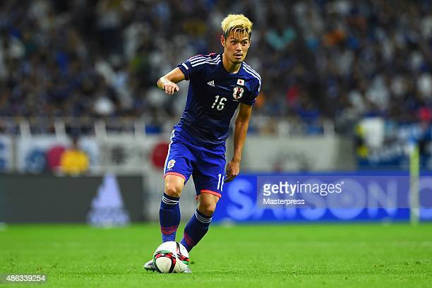 Hotaru Yamaguchi of Japan in action during the 2018 FIFA World Cup Qualifier Round 2 Group E match between Japan and Cambodia at Saitama Stadium on...