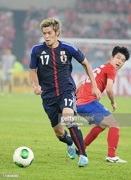 Hotaru Yamaguchi of Japan in action during the EAFF East Asian Cup match between Korea Republic and Japan at Jamsil Stadium on July 28 2013 in Seoul...