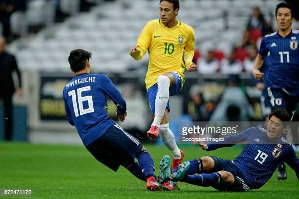 Hotaru Yamaguchi of Japan Neymar Jr of Brazil Hiroki Sakai of Japan during the International Friendly match between Japan v Brazil at the Stade...
