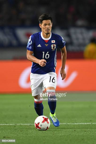 Hotaru Yamaguchi of Japan runs with the ball during the international friendly match between Japan and Syria at Tokyo Stadium on June 7 2017 in Chofu...