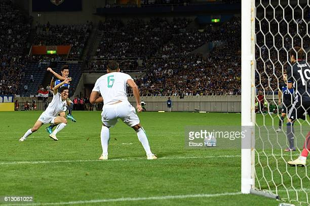 Hotaru Yamaguchi of Japan scores his team's second goal during the 2018 FIFA World Cup Qualifiers match between Japan and Iraq at Saitama Stadium on...