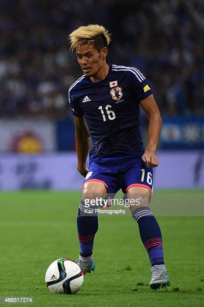 Hotaru Yamaguchi of Japan trapps the ball [action] during the 2018 FIFA World Cup Qualifier Round 2 Group E at Saitama Stadium on September 3 2015 in...
