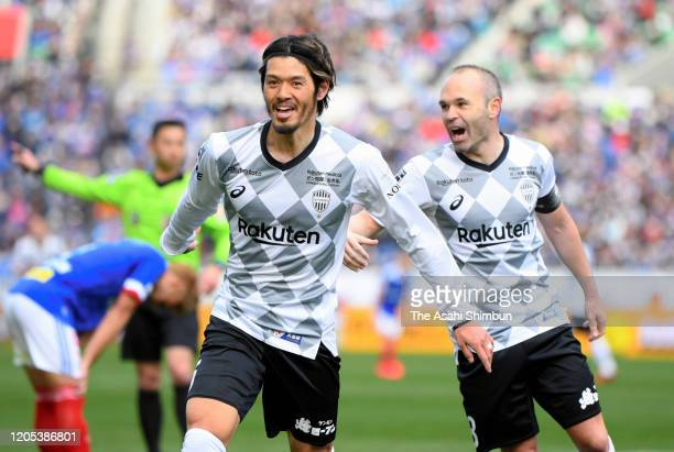 Hotaru Yamaguchi of Vissel Kobe celebrates scoring his side's third goal with his team mate Andres Iniesta during the Fuji Xerox Super Cup match...