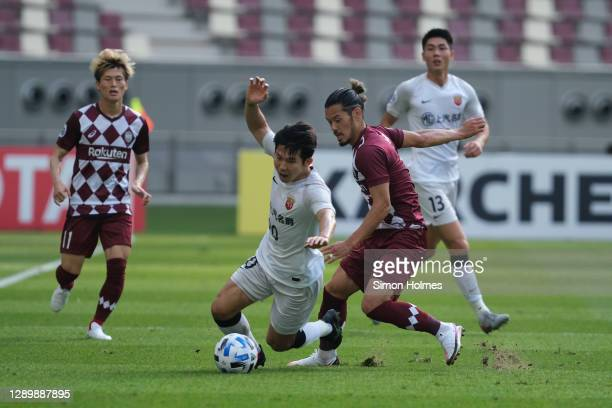 Hotaru Yamaguchi of Vissel Kobe challenges Shanghai SIPG's Yang Shiyuan during the AFC Champions League Round of 16 match between Vissel Kobe and...