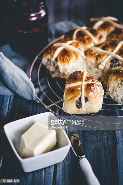 hot-cross-buns with raisins, blackcurrant jelly and butter - hot cross bun stock pictures, royalty-free photos & images