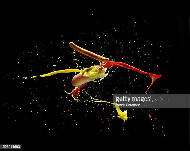 hotdog splashing in air - ketchup stock pictures, royalty-free photos & images