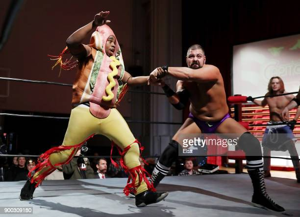 Hotdog Starkea is thrown by Shawn Dovovan during Capitol Wrestling World War IV on December 29 2017 at Capitol Auditorium in Hoboken New Jersey