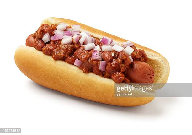a hotdog with chili sauce and onions - hot dog stock pictures, royalty-free photos & images