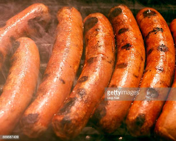 Hotdogs on the grill.