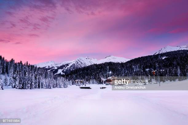 hotel at foot of mountains in winter, madonna di campiglio, italy - マドンナディカンピリオ ストックフォトと画像