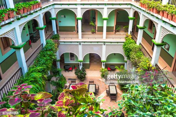 Hotel Barcelona central backyard decorated with beautiful plants The famous place is a revitalized colonial building in the center of the village