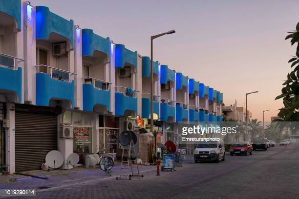 hotel building with blue lights at dawn,ilica. - emreturanphoto stock pictures, royalty-free photos & images