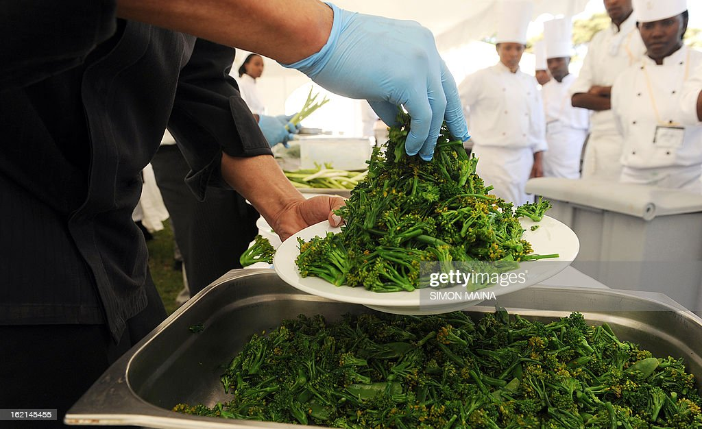Hotel chefs prepare to serve rejected green salad, grown by Kenyan farmers but rejected by UK supermarkets due to cosmetic imperfections, on February 19, 2013 during the Governing Council of the United Nations Environment Programme (UNEP) at the UN headquarters in Nairobi. The campaign aims to promote actions by consumers and food retailers to dramatically cut the 1.3 billion tonnes of food lost or wasted each year -- which, aside from the cost implications and environmental impacts, increases pressure on the already straining global food system -- and help shape a sustainable future.