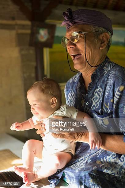 Hotel concierge holding baby