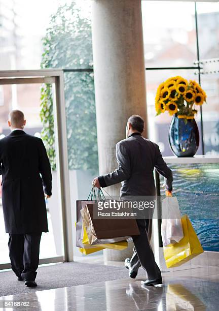 Hotel concierge takes out shopping bags