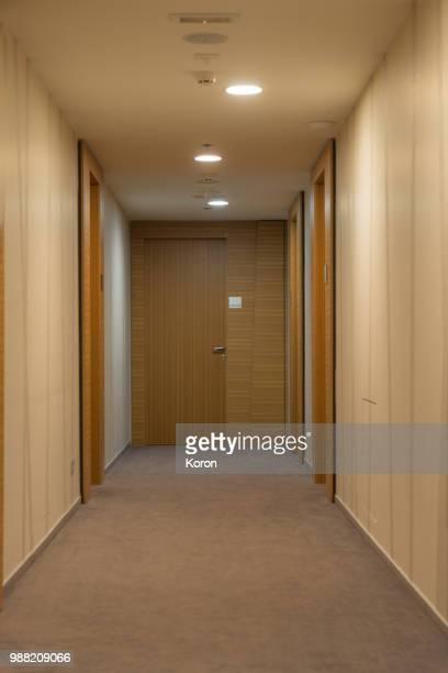 hotel corridor - corridor stock pictures, royalty-free photos & images