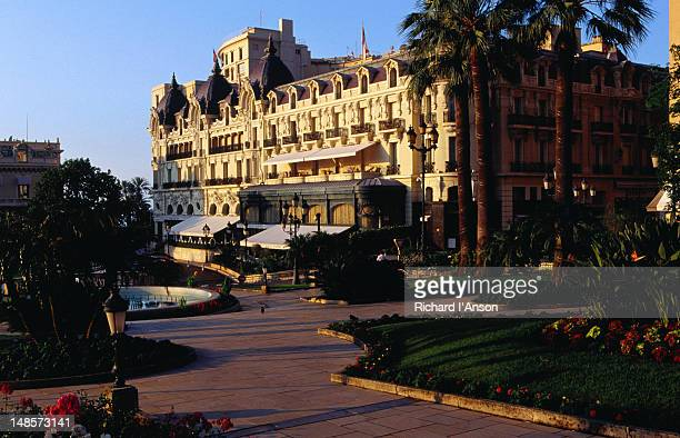 hotel de paris with jardins du casino. - monte carlo stock pictures, royalty-free photos & images