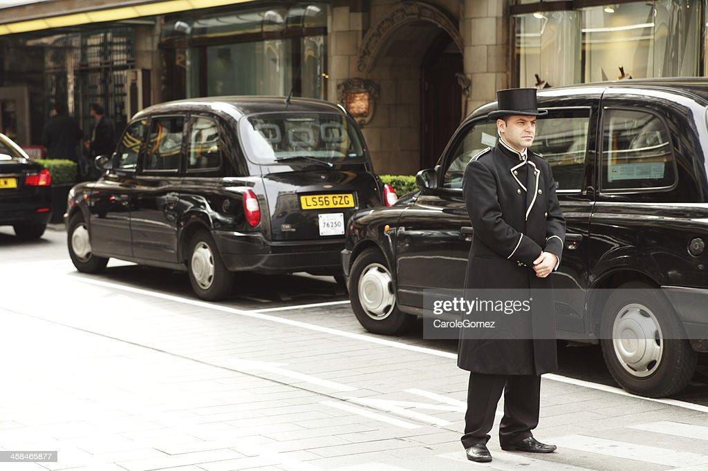 Hotel Doorman in London : Stock Photo