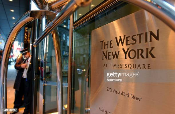 A hotel doorman speaks on the phone as he helps the guests at a Westin Hotel on 43rd Street in midtown Manhattan on Wednesday October 26 in New York...