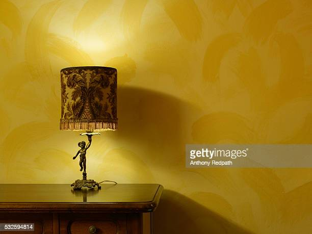 Hotel Dresser with Lamp and Yellow Wall