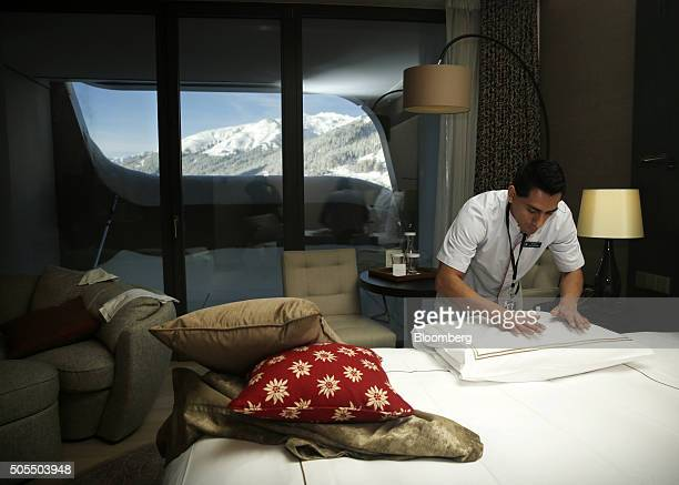 A hotel employee prepares the bedding inside a bedroom suite at the InterContinental Hotel Davos operated by InterContinental Hotels Group Plc ahead...