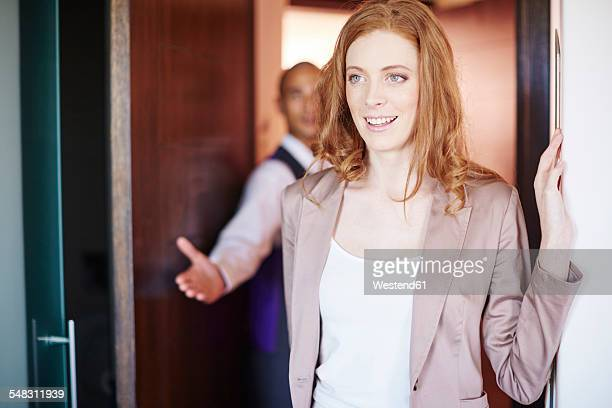 hotel employee showing hotel guest her room - guest stock pictures, royalty-free photos & images