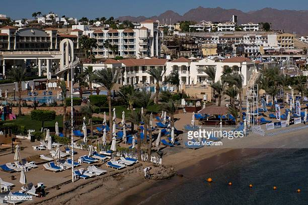 A hotel employee works on the shoreline in the resort town of Naama Bay on April 1 2016 in Sharm El Sheikh Egypt Prior to the Arab Spring in 2011...