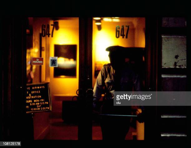Hotel entrance in New York at night with policeman