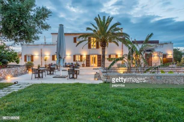 hotel facade at night - spain stock pictures, royalty-free photos & images
