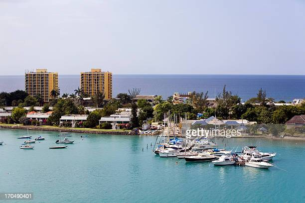 Hotel garden and boats in dock and anchored at resort in Montego Bay Jamaica Caribbean