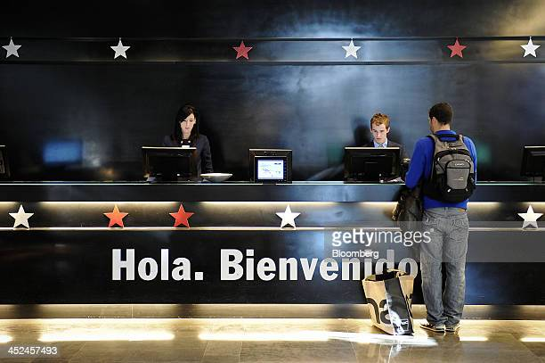 A hotel guest stands at the reception desk as he checks in at the NH Constanza hotel operated by NH Hoteles SA in Barcelona Spain on Thursday Nov 28...