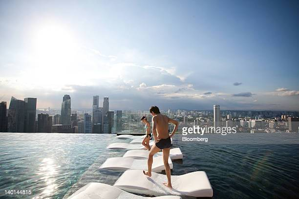 Hotel guests are seen at the infinity pool at the SkyPark atop Marina Bay Sands in Singapore on Tuesday Feb 28 2012 The number of visitors to the...