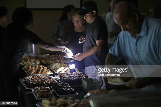 Hotel guests are served breakfast by lamplight as the power remains off at the Courtyard by Marriott one day after Hurricane Irma struck the state...