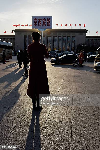 Hotel hostess waits for delegates at the Great Hall of the People after the Second Plenary Meeting of the National People's Congress, on March 9,...