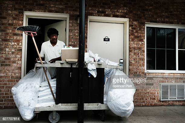 A hotel housekeeper works in Pensacola on December 4 2016 in Pensacola Florida Pensacola along with much of the Panhandle regions along the Gulf...