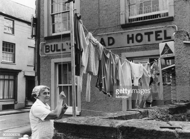 Hotel Landlady Mrs Maureen Roach puts up another line of washing outside the Bull's Head Hotel Brecon a market town and community in Powys Mid Wales...