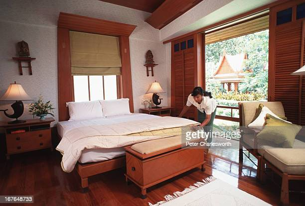 A hotel maid makes up one of the Thaistyle rooms at the Chiva Som Health Resort one of the regions best and most expensive spas