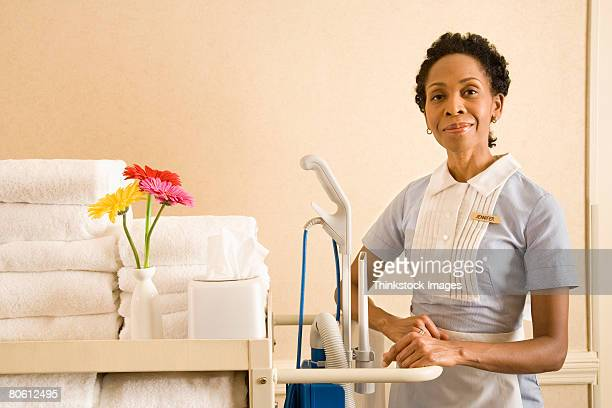 Hotel maid with cart