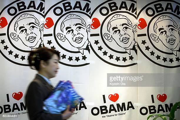 Hotel manager Hidemi Fujiwara works in front of banners in support of the Democratic presidential candidate US Sen Barack Obama at Hotel Sekumiya on...